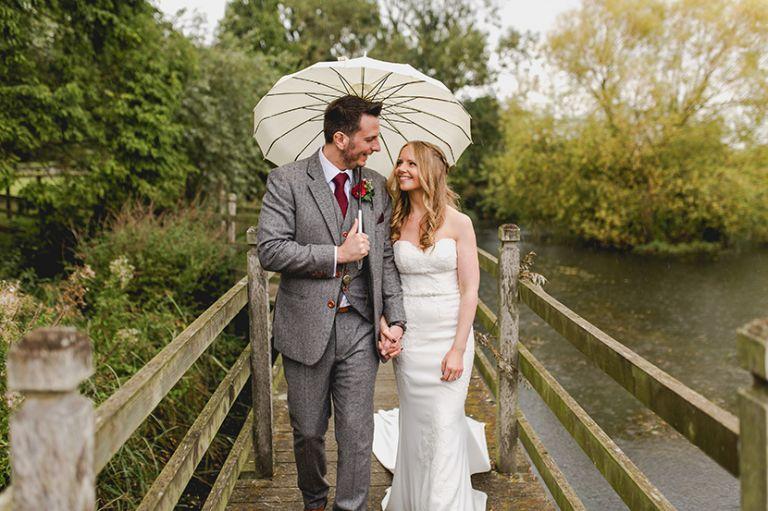 couple under a white umbrella