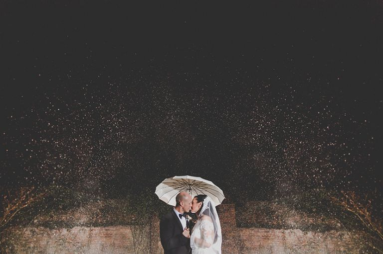couple at gaynes park in the rain