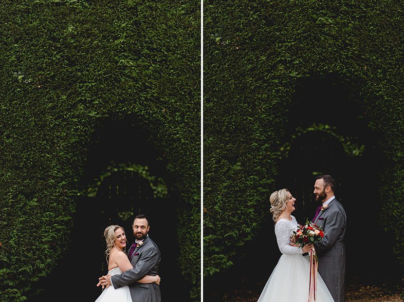 bride and groom smile at eachother