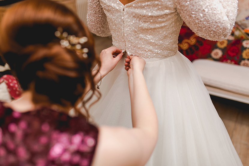 brides wedding dress put on