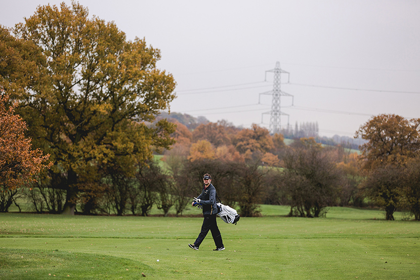 groom plays golf