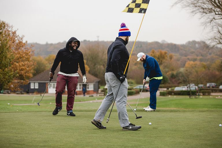 groom and friends play golf