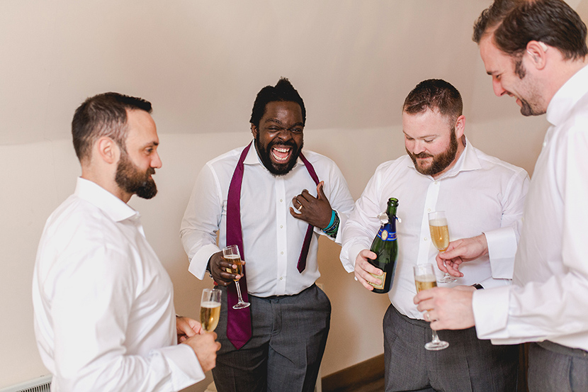 groomsmen have drinks together