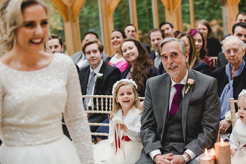 father of the bride looks proudly on