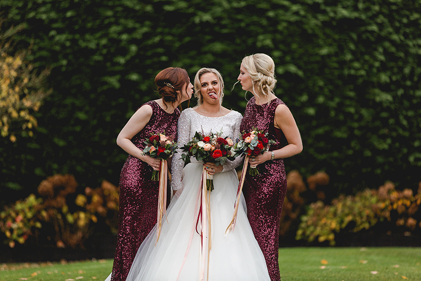 bride and bridesmaid pull funny faces