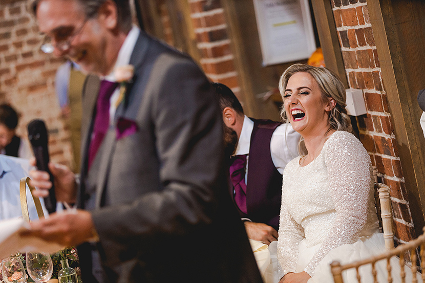 bride laughs at speech