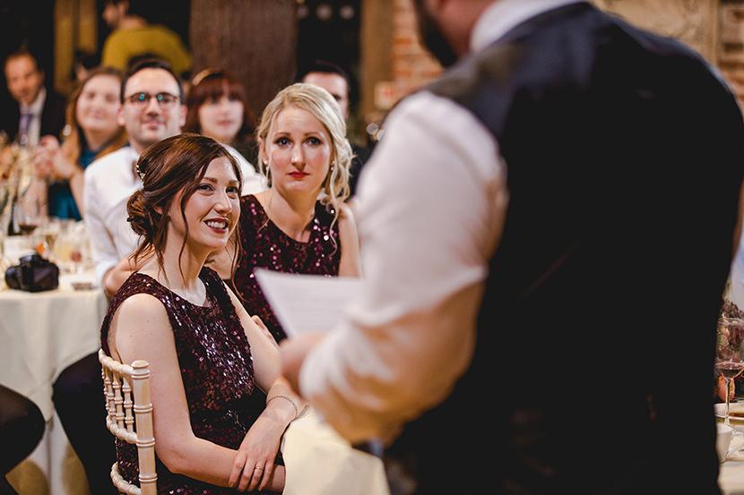 bridesmaid smiles during speech