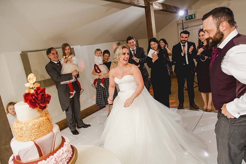 bride and groom walk to cake