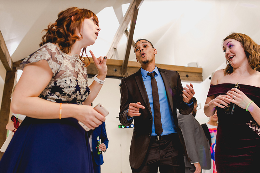 guests sing at wedding