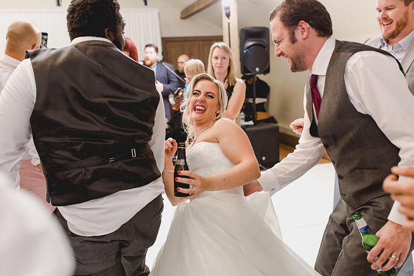 bride grinds with groomsmen