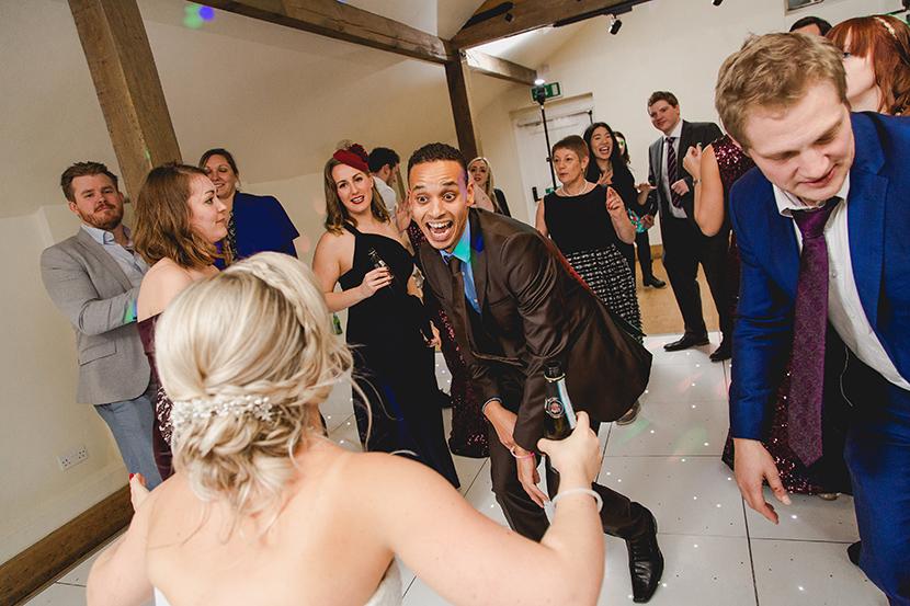 friends dance at wedding