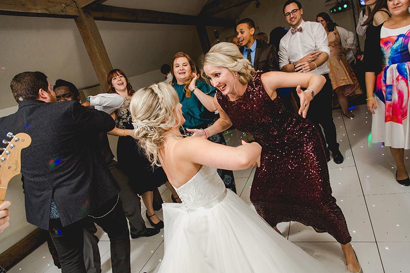 bride dances with bridesmaid