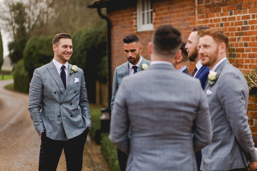 groomsmen greeting guests