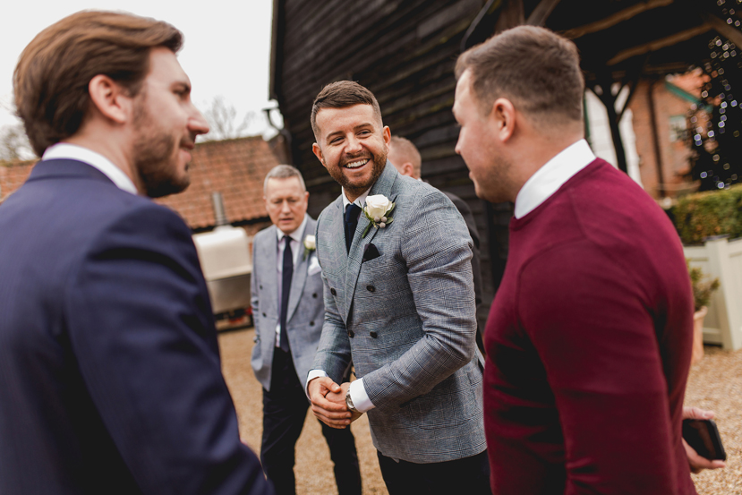 groom greeting guests