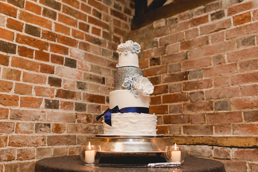 silver and blue and white wedding cake