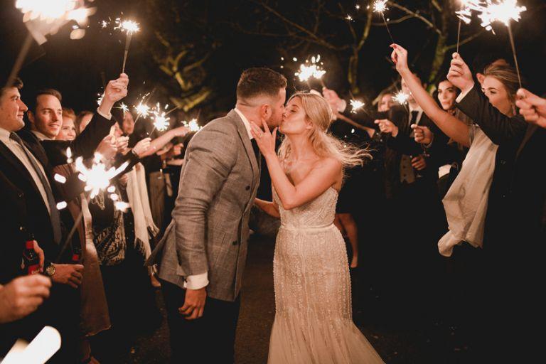 bride and groom sparklers at gaynes park