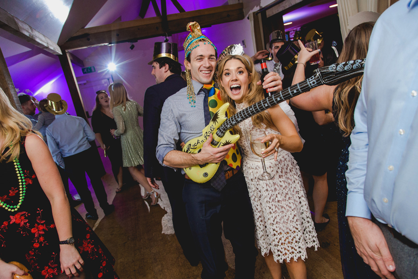 wedding guest with inflatable guitar