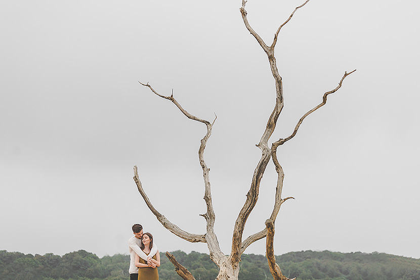 Best engagement shoot locations in Essex, engaged couple in a field