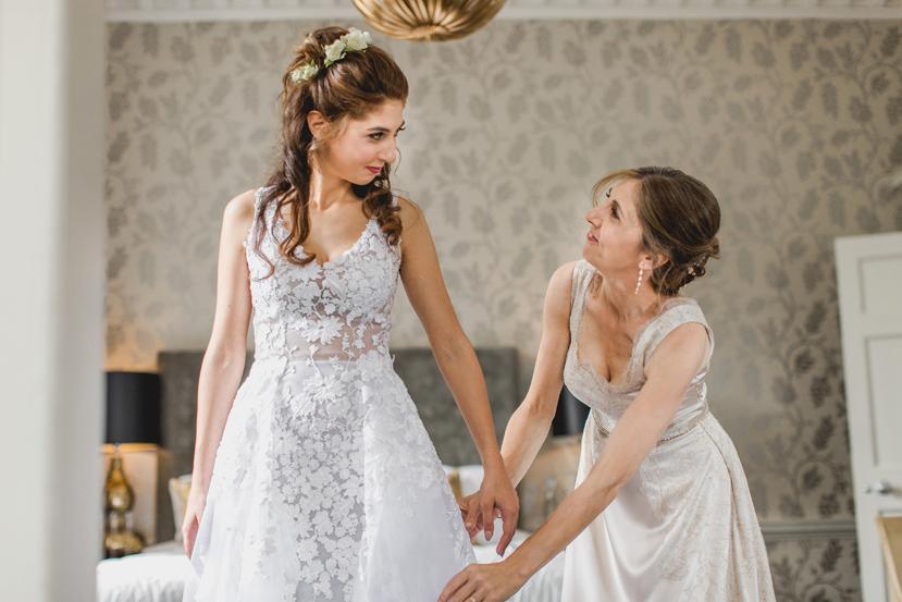 mum during bridal prep at wedding