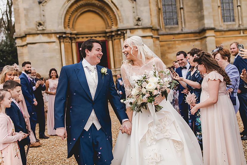 Bride and Groom posing at woburn safari park for their wedding photos