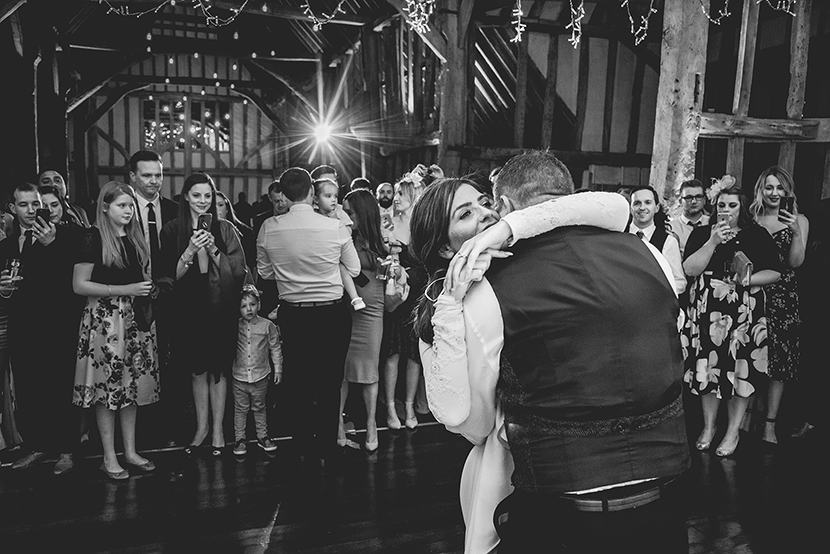 black and white photo of bride and groom on dancefloor