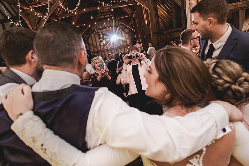 people hugging on dancefloor