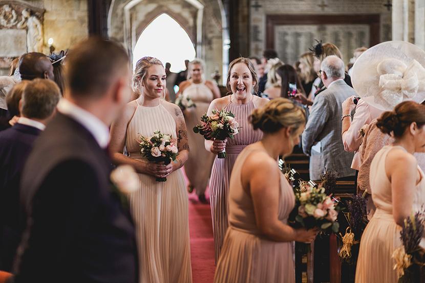 bridesmaids walking down the aisle at waltham abbey