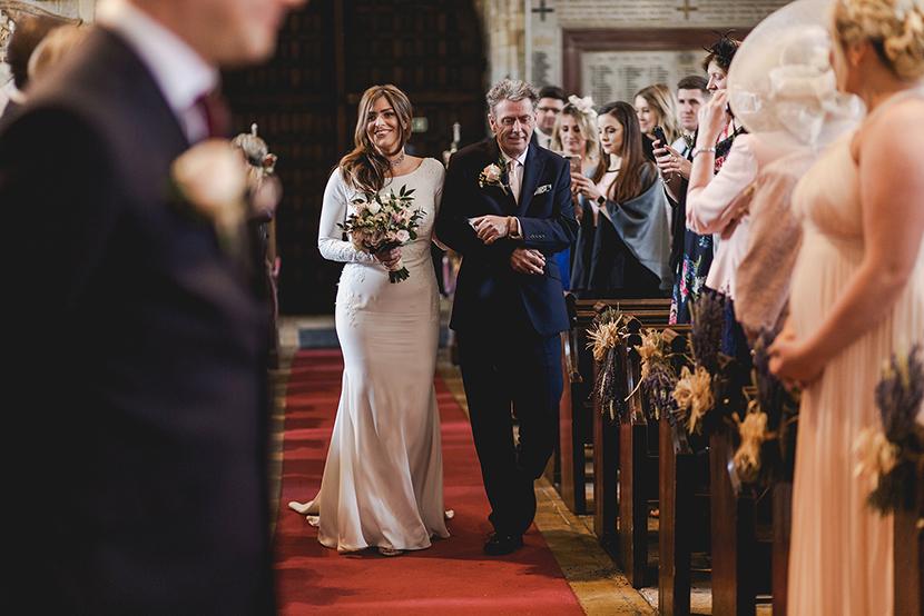 bride walking down the aisle at Waltham abbey