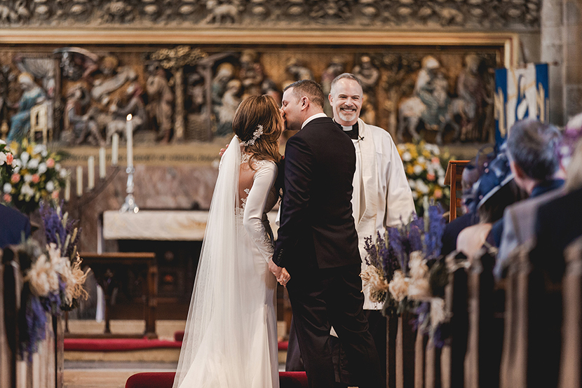 bride and groom during wedding ceremony at Waltham abbey