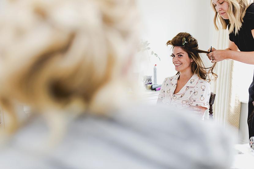 bride having her hair done