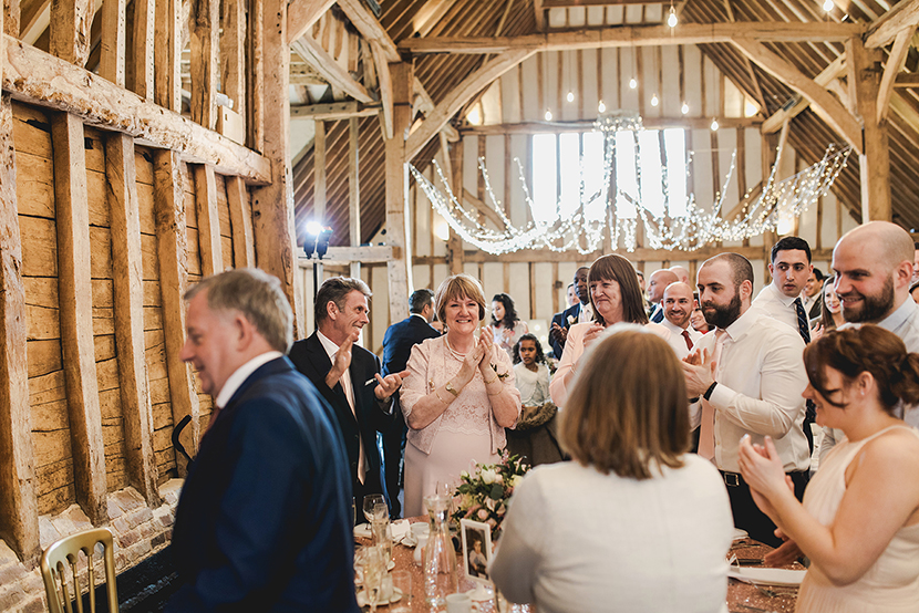 guests clapping at wedding speech