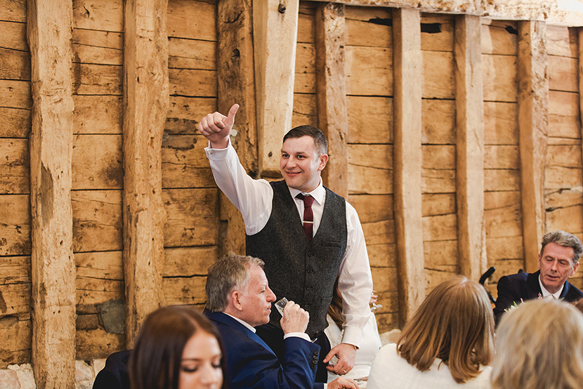 groom giving the thumbs up