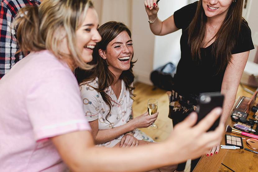 bride laughing with friends
