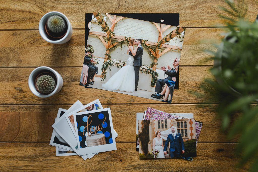 photograph of wedding photo prints on wood