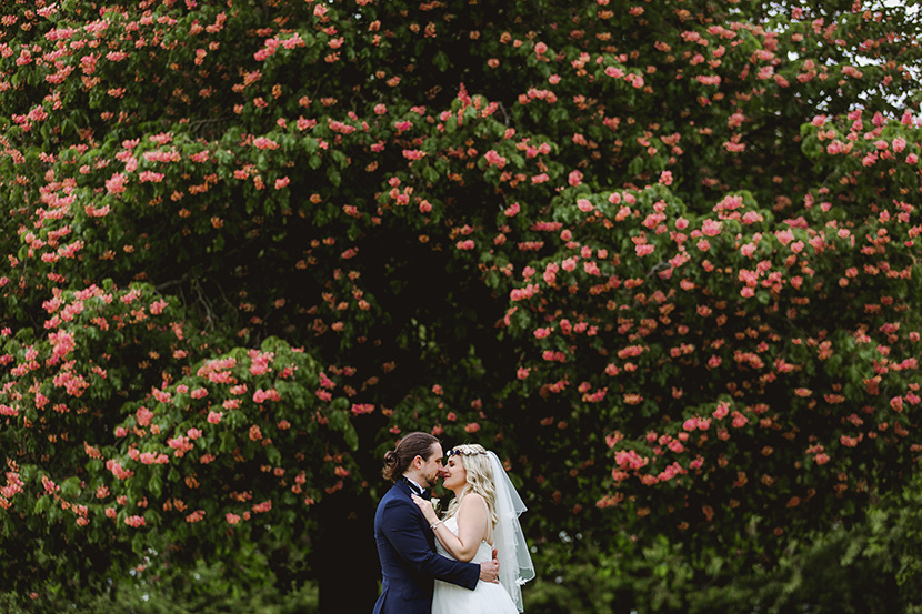 bride and groom kiss at leez priory