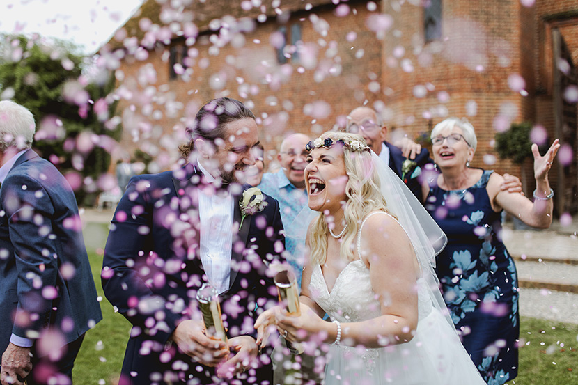 essex wedding photographers Sam and Louise photography capture a gender reveal at a wedding with pink confetti