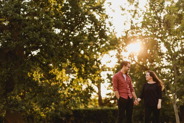 couple smiling during Engagement shoot at Hylands house in Essex