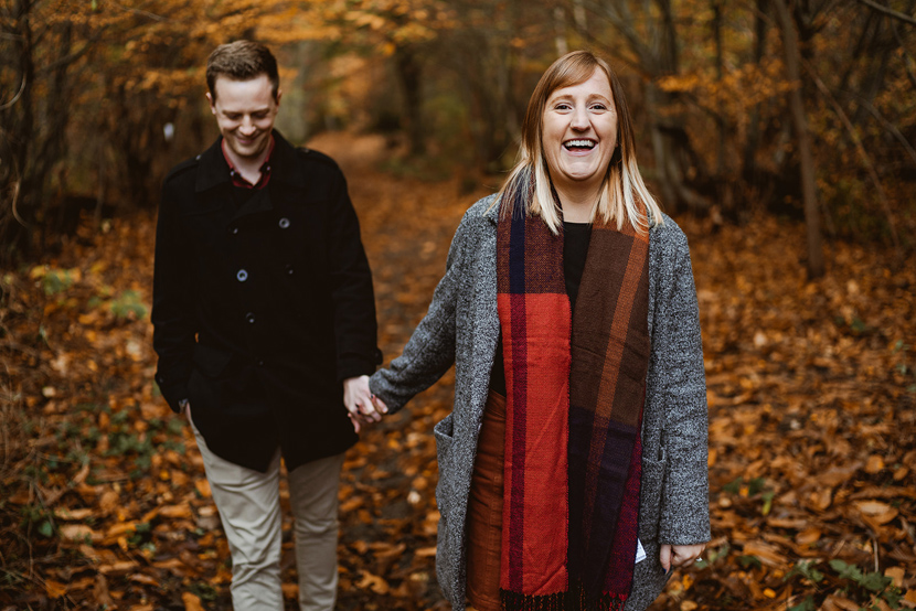 couple smiling in woodland in Lincolnshire