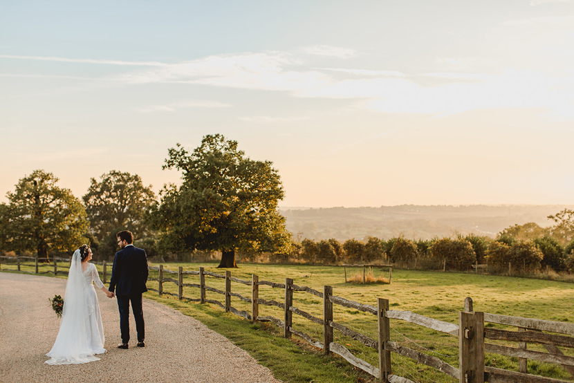 bride and groom in Autumn at Gaynes Park