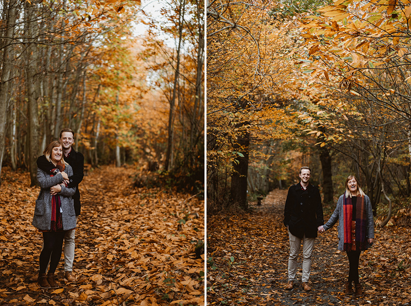 couple smiling in autumn forest