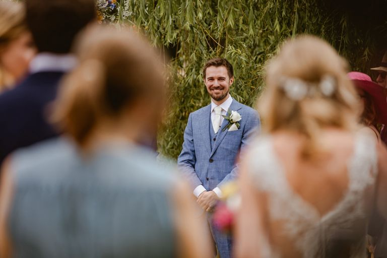 the moment the groom sees his bride walking down the aisle towards him for the first time