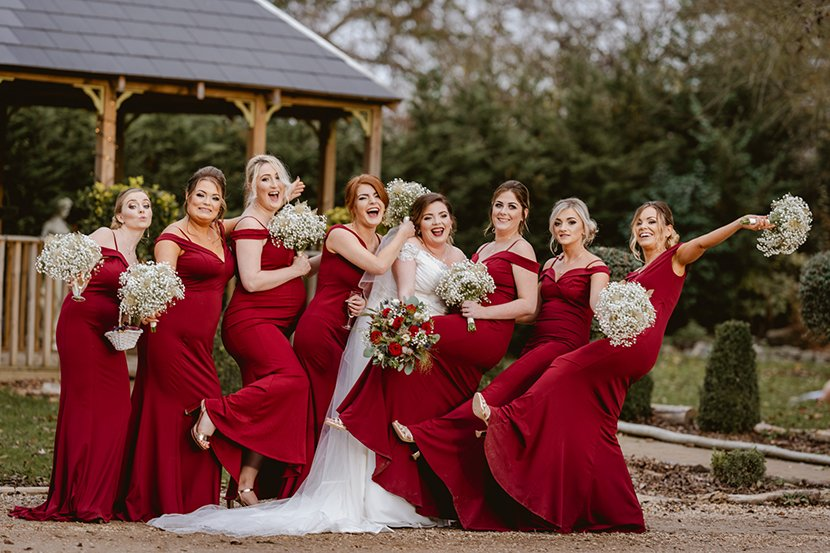 bride and bridesmaids laugh and joke during group photographs