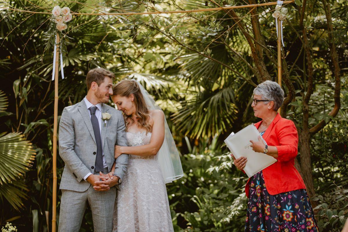 bride leans on grooms shoulder