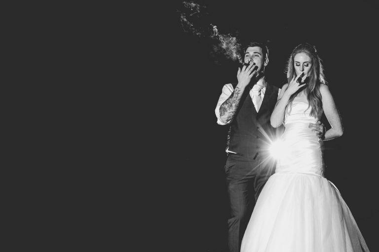 bride and groom smoking cigars